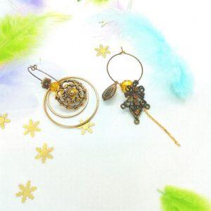 Paire de boucles d'oreilles asymétriques Vintage modèle anneaux et ambre