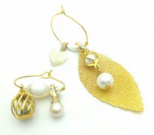 Paire de boucles d'oreilles asymétriques Vintage modèle Feuille d'or